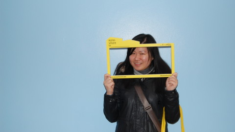 Young person holding somewhereto_ frame